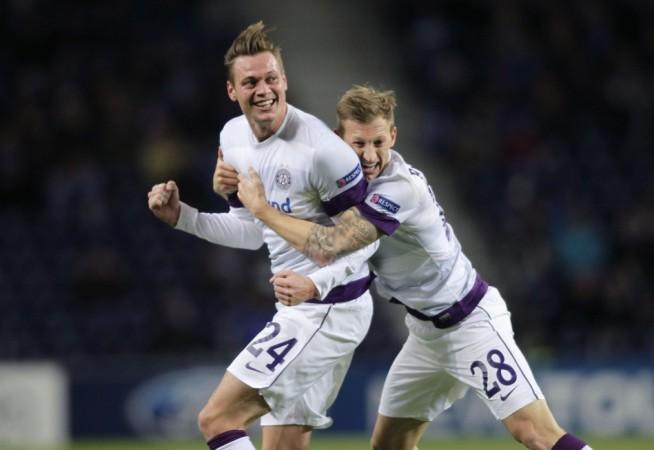 Austria Wien's Kienast and Royer celebrate a goal against Porto