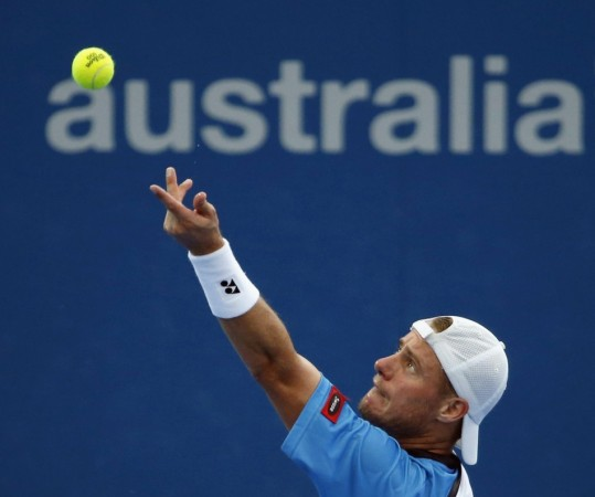 Lleyton Hewitt of Australia serves to Marius Copil of Romania during their men's singles match at the Brisbane International tennis tournament in Brisbane, January 3, 2014.