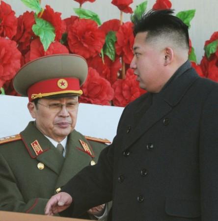 North Korean leader Kim Jong-un (R), flanked by his uncle North Korean politician Jang Song Thaek