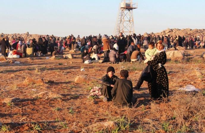 Syrian refugees, fleeing the violence, wait to enter Turkey on the Syrian-Turkish border in Shamm Alqrain village.