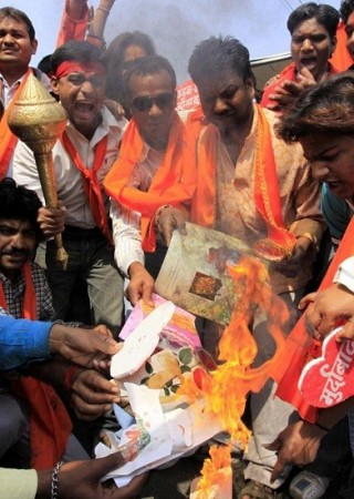 Activists of Bajrang Dal burn greeting cards shout slogans during protest against Valentine's Day celebrations in Bhopal/Reuters File