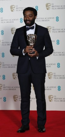 "Chiwetel Ejiofor celebrates after winning Best Actor for ""12 Years a Slave"" at the BAFTA awards ceremony in London"