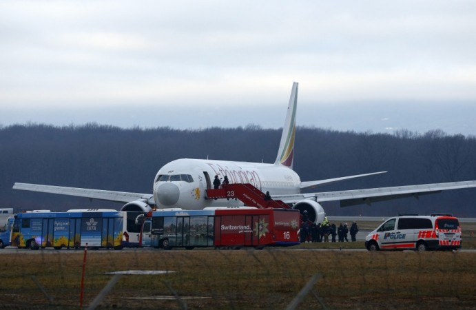 Police officers stand around hijacked Ethiopian Airlines flight ET 702 at Cointrin airport in Geneva