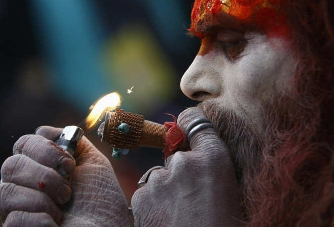 A Hindu holy man, or sadhu, smokes marijuana on a chillum (pipe) at the premises of Pashupatinath Temple during the Shivaratri festival in Kathmandu February 27, 2014.