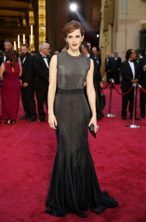 Actress Emma Watson poses on the red carpet as she arrives at the 86th Academy Awards in Hollywood