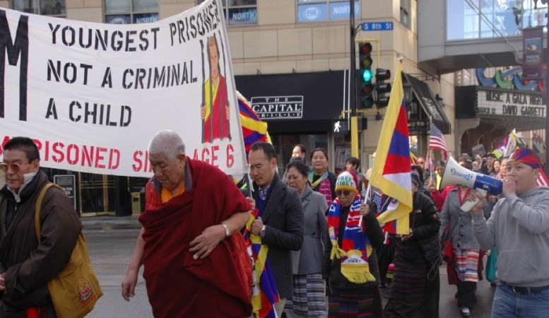 Tibetans rally across Minneapolis downtown to mark the 55th Tibetan national uprising anniversary in Minnesota, U.S.A (Photo Credit: Tendar Tsering)