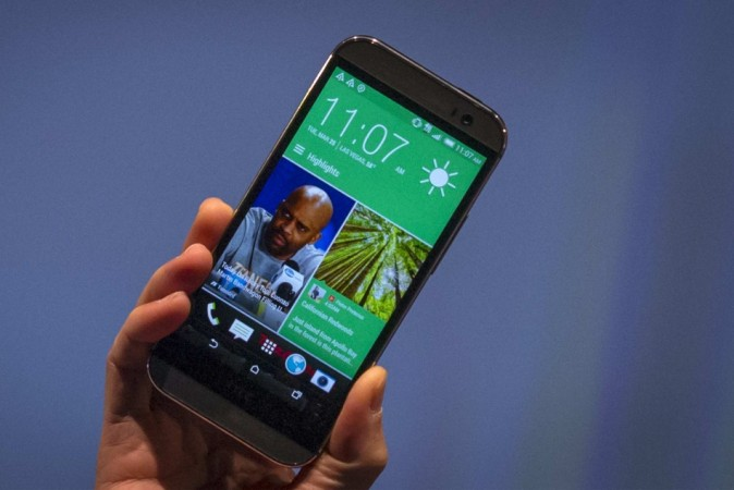 Chou shows the new HTC One M8 phone during a launch event in New York