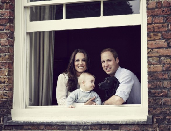 Britain's Prince William, Catherine, Duchess of Cambridge and their son Prince George, are seen in this photograph taken in Kensington Palace, London