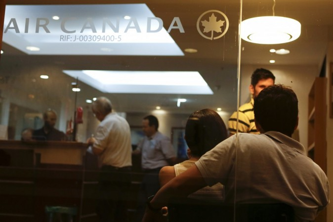 Customers wait their turn to be served at the Air Canada's office in Caracas