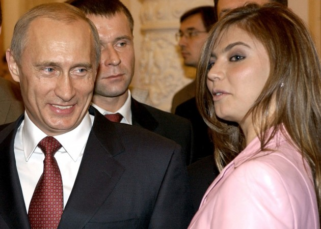 Vladimir Putin Looks at Alina Kabayeva (Photo: Reuters)
