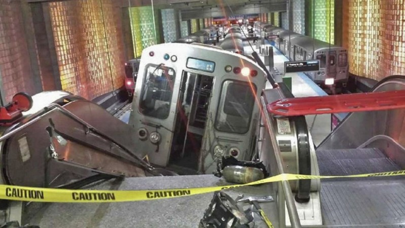 A derailed commuter train rests on an escalator at O'Hare international airport in Chicago (Photo: Reuters)