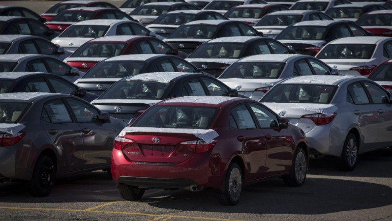 New cars are seen at the Toyota plant in Cambridge