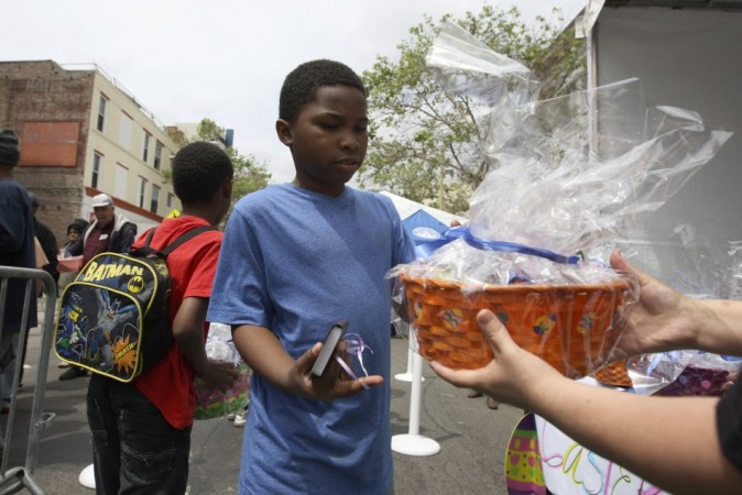 Easter 2014: A boy receives an Easter basket at a Good Friday Easter event sponsored by the Los Angeles Mission to help the homeless and near-homeless of Skid Row in Los Angeles, California. (Photo: Reuters)