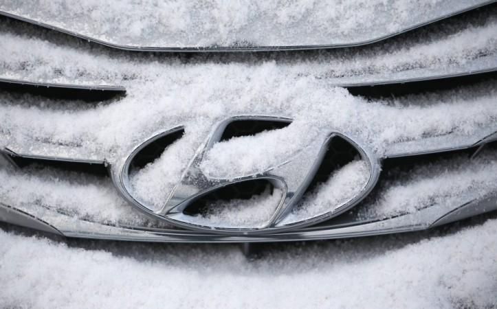 File photo of a logo of Hyundai Motor on a sedan covered with snow at a shipping yard in Pyeongtaek