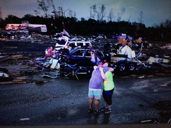 Lori Berseth is consoled after searching for her missing black labrador dog Lucille after a tornado destroyed the town of Mayflower (Photo: Reuters)