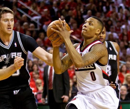 5fc25f0c428 Portland Trail Blazers  Damian Lillard drives to the basket against the San  Antonio Spurs.Reuters