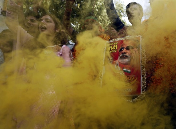 Supporters of India's BJP hold a portrait of Hindu nationalist Modi during celebrations in New Delhi