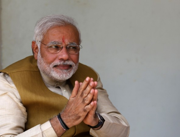 Hindu nationalist Narendra Modi, the prime ministerial candidate for Bharatiya Janata Party, gestures after seeking blessings from his mother Heeraben in Gandhinagar