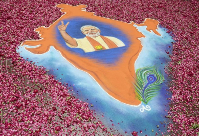 A rangoli showing a map of India with an image of Modi, prime ministerial candidate for BJP, is pictured in the premises of the party's regional office in the western Indian city of Ahmedabad