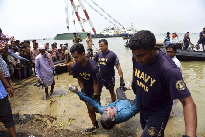 Members of the Bangladesh Navy recover the body of a passenger from the capsized M.V. Miraj 4 ferry by the Meghna river at Rasulpur in Munshiganj district
