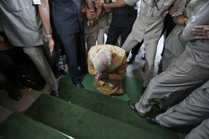Hindu nationalist Modi the prime ministerial candidate for India's BJP bows down in respect at the steps of the parliament house