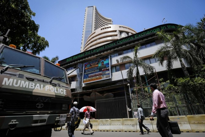 People walk past the BSE building in Mumbai