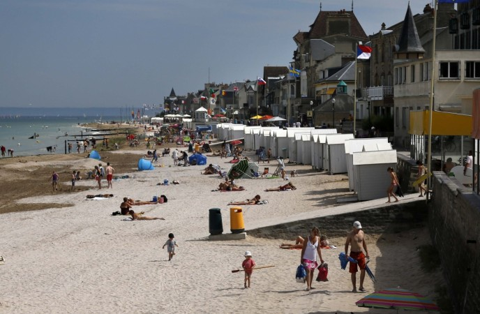 Tourists enjoy the sunshine on the former Juno Beach D-Day landing zone in Saint-Aubin-sur-Mer (Present Day)