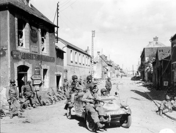 Handout photo of U.S. Army paratroopers of the 101st Airborne Division driving a captured German Kubelwagen on D-Day in Carentan
