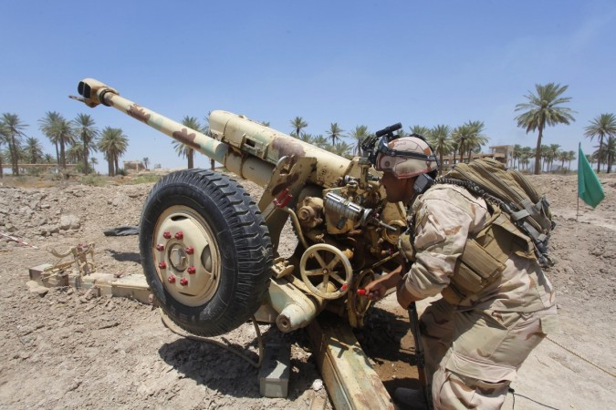 Iraqi security forces fire artillery during clashes with Sunni militant group Islamic State of Iraq and the Levant in in Jurf al-Sakhar