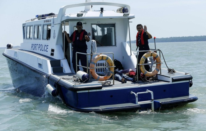 The two bodies of suspected illegal Indonesian immigrants are seen inside a Malaysian Port Police boat during a search and rescue with the Malaysia Maritime in Kuala Langat