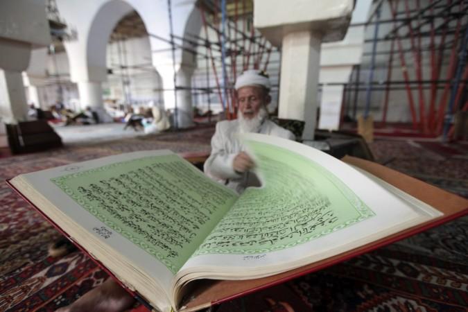 A man reading Koran
