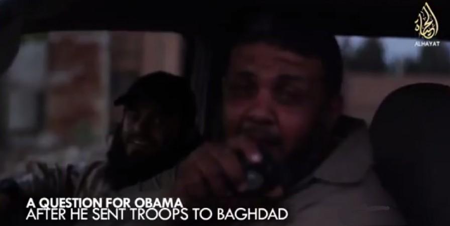 A jihadist mocks Obama,while Abu Safiyya wearing baseball cap is seen smiling.