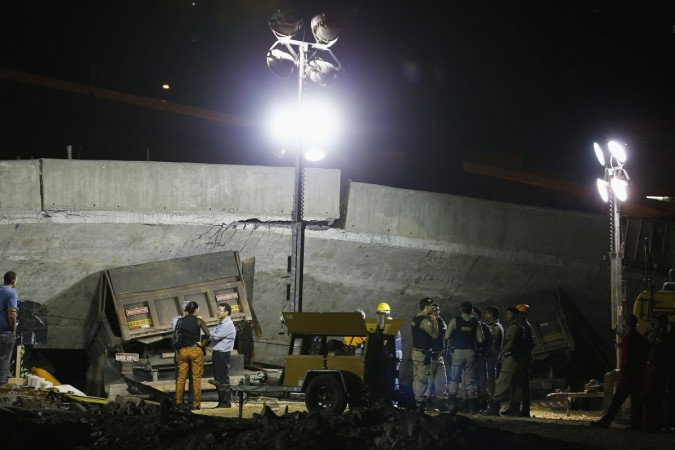 Vehicles are trapped underneath bridge that collapsed while under construction in Belo Horizonte