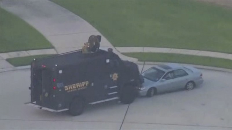 Still image taken from KPRC-TV aerial video footage of police and suspect's vehicles in a standoff at a residential neighborhood following a shooting incident in Spring, Texas