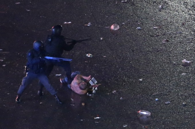 Argentina's fans clash with riot police after Argentina lost to Germany in 2014 World Cup final soccer match in Brazil, at a public square viewing area in Buenos Aires