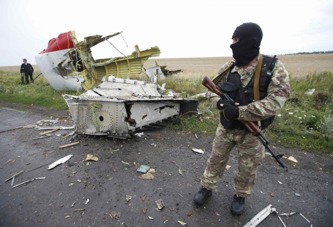 A team of international observers set to investigate the alleged downing of the Malaysian Airlines Flight MH17 have been blocked by 'drunk' rebels.
