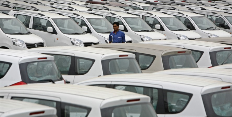 A worker walks at a Maruti Suzuki stockyard on the outskirts of the western Indian city of Ahmedabad July 28, 2012. Maruti Suzuki, India's biggest carmaker, lagged estimates with a 23 percent fall in fiscal first-quarter profit, its fourth consecutive qua