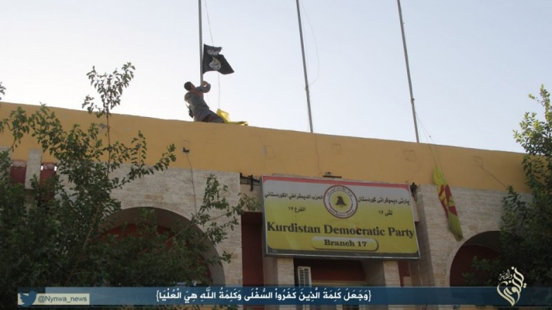 ISIS militant hoists flag in Sinjar