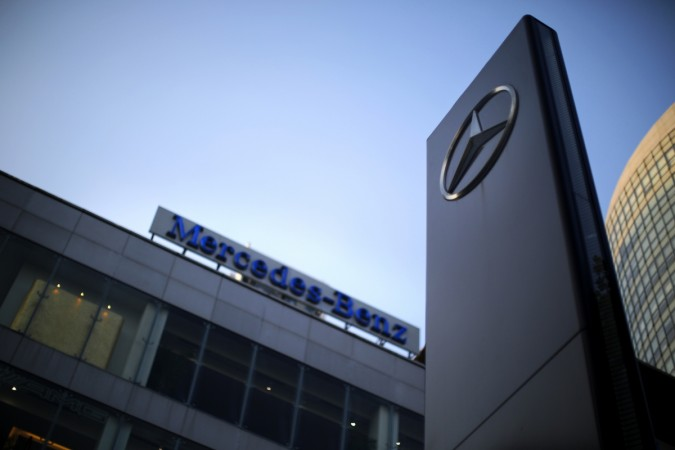 A Mercedes-Benz logo and sign are seen at a dealership
