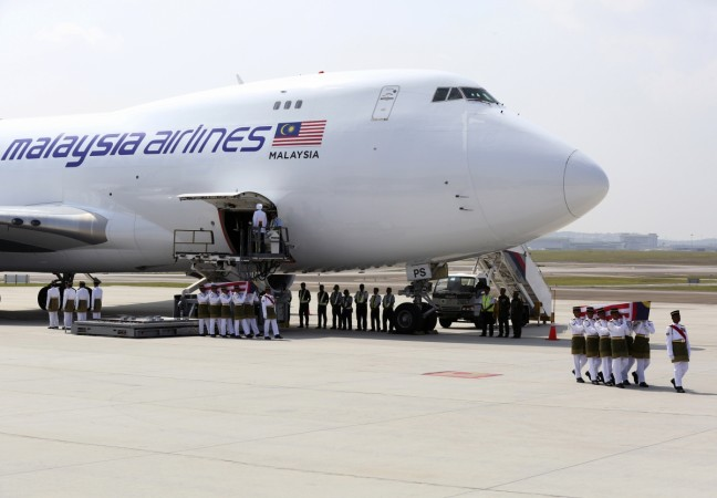 People across Malaysia held a minute's silence and wore black on Friday after bodies of MH17 victims finally arrived.