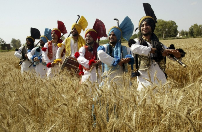 a traditional punjabi dance at a wheat field on the eve of the baisakhi festival in punjab baisakhi or vaisakhi is the beginning of the new year in