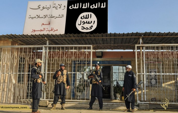 Islamic State Army police outside its newly setup police station in Mosul