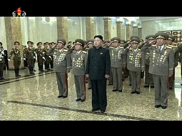 A smiling Kim Jong-un appeared in North Korean state television walking with the aid of a stick.