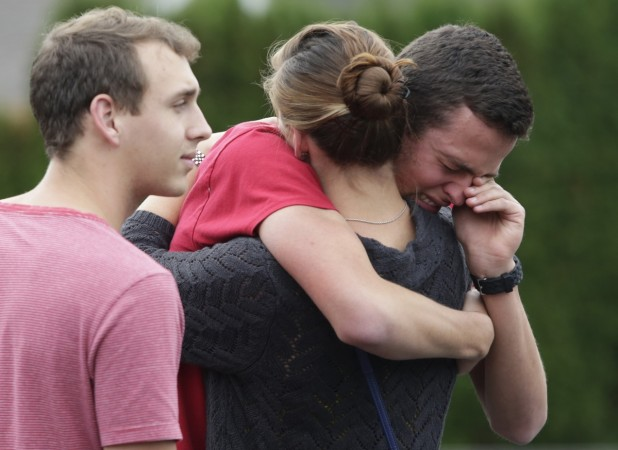 Students and family members reunite at Shoultes Gospel Hall after a student opened fire at Marysville-Pilchuck High School in Marysville, Washington October 24, 2014.