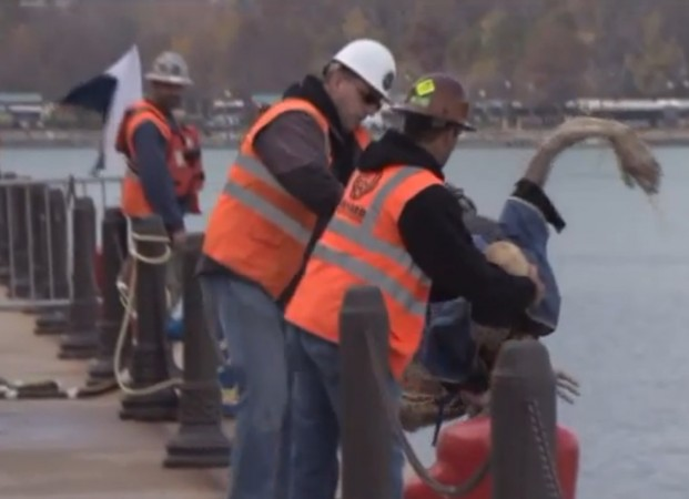Rescue workers pull  a zombie out of Lake Michigan