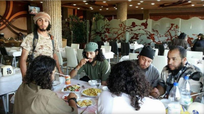ISIS militants having food together in a posh hotel in Raqqa,Syria.