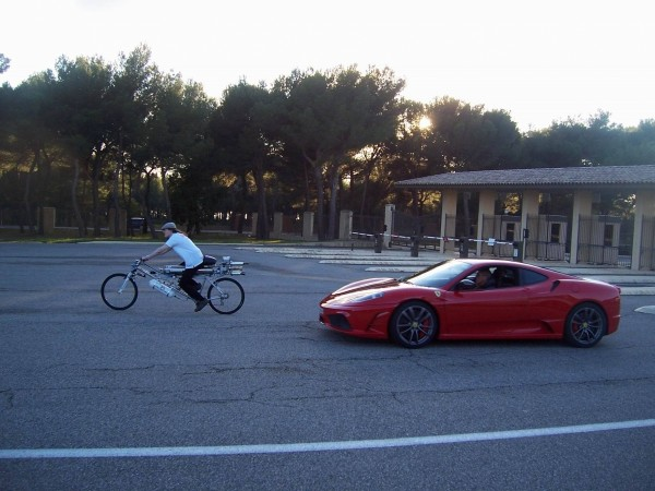 cycle beats Ferrari in race
