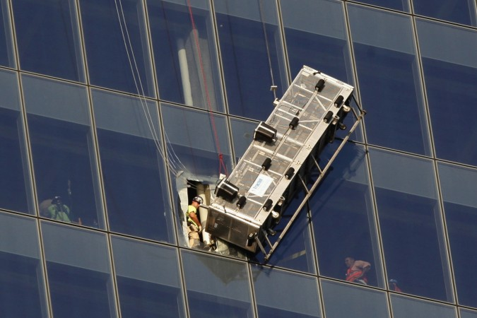 In a dramatic World Trade Center Rescue, two window washers dangling nearly 70 stories above ground were saved by firefighters.