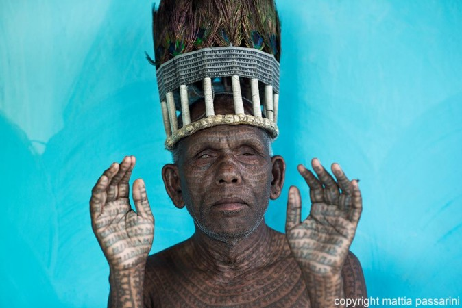 Italian photographer Mattia Passarini's photograph of Ramnami tribal people receives honourable mention in National Geographic 2014 Photo Contest