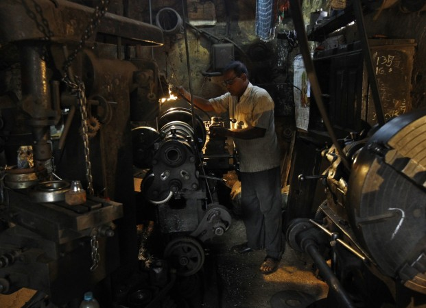 A man works inside a bridge component manufacturing unit in Kolkata